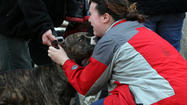 A dog was pulled out of a three-story Bridgeport neighborhood building after it caught fire this afternoon.