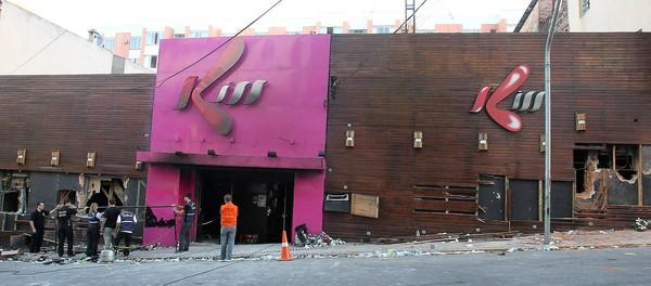Investigators inspect the entrance of the Kiss nightclub in Santa Maria, Brazil, where at least 231 people were killed in a fire.