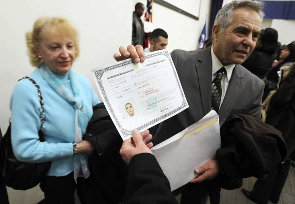 Holocaust survivor Adam Paluch holds his certificate of U.S. citizenship Monday after a ceremony at U.S. Citizenship and Immigration Services in Chicago, with his twin sister, Ida Kersz, at his side.