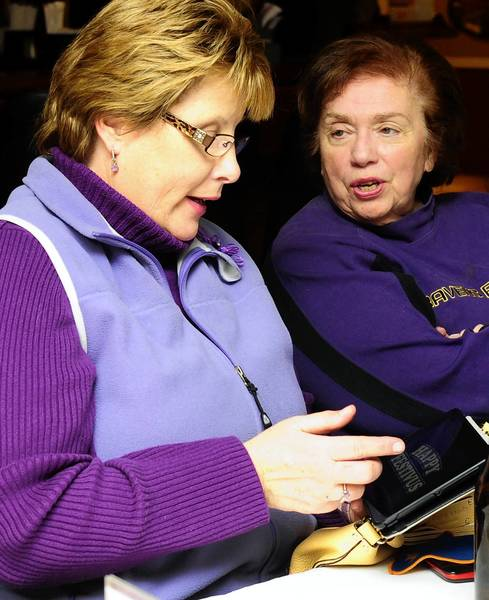 Harford Nest #1 members Kathy Smero, left, and Pat Skebeck talk about the season of memories as they and other members meet at the Tower Restaurant in Bel Air Friday night to finalize plans for the road trip to the Super Bowl.