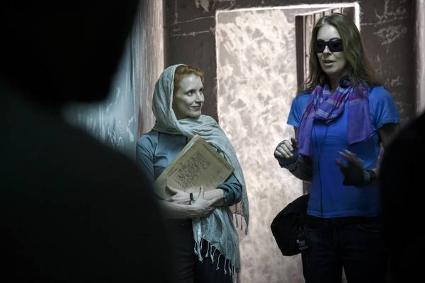 "Jessica Chastain, left, and Kathryn Bigelow on the set of the movie ""Zero Dark Thirty."""