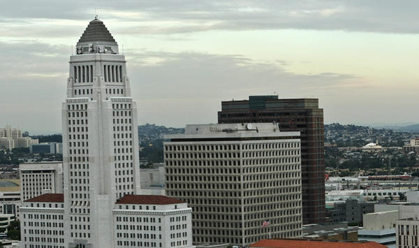 In picking a mayor, voters are also picking a team. Above: Los Angeles City Hall is seen, far left, in Nov. 2012.