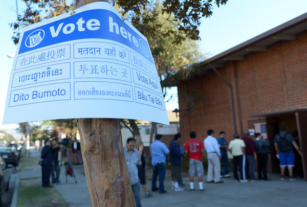 Sun Valley residents wait in line to vote at the polling station located at Our Lady of The Holy Church on election day.