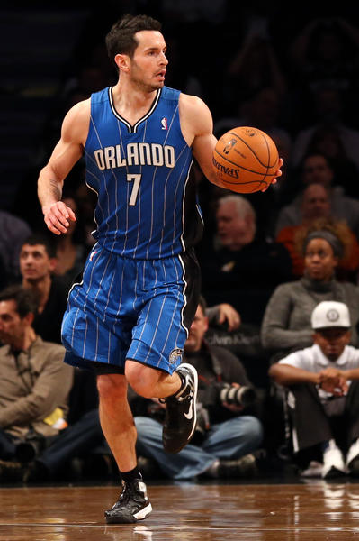 Orlando Magic shooting guard J.J. Redick (7) advances the ball during the first quarter against the Brooklyn Nets at Barclays Center.