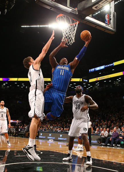Glen Davis #11 of the Orlando Magic scores against Brook Lopez #11, and Reggie Evans #30 of the Brooklyn Nets during their game at the Barclays Center on January 28, 2013 in the Brooklyn borough of New York City