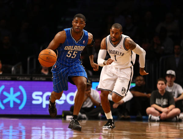 E'Twaun Moore #55 of the Orlando Magic dribbles against C.J. Watson #1 of the Brooklyn Nets during their game at the Barclays Center on January 28, 2013 in the Brooklyn borough of New York City.