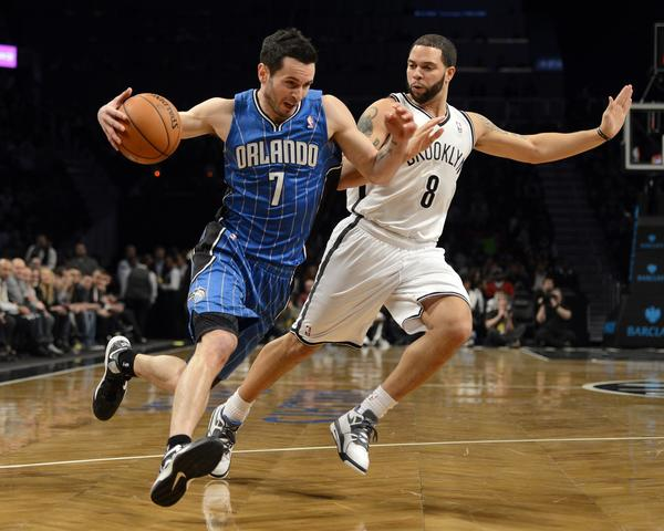 Brooklyn Nets Deron Williams (R) guards Orlando Magic J.J. Redick (L) during their NBA game at the Barclays Center on January 28 , 2013 in the Brooklyn borough of New York City.