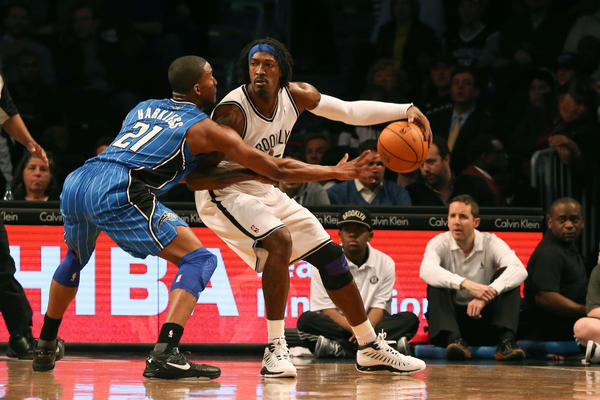 Brooklyn Nets small forward Gerald Wallace (45) drives around Orlando Magic small forward Moe Harkless (21) during the first quarter at Barclays Center.