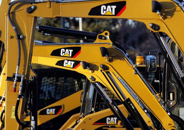 Caterpillar reported Monday that its fourth-quarter profit fell 55 percent, mainly due to a $580 million write-down of a Chinese acquisition.