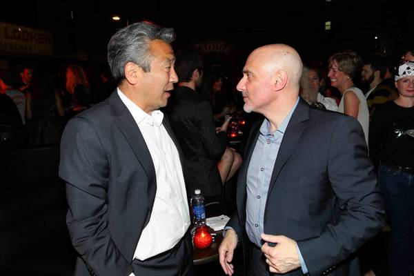 "Warner Bros. Chief Executive Kevin Tsujihara, right, reportedly gets along well with Warner Pictures Group President Jeff Robinov. They are shown chatting at the premiere of ""Rock of Ages"" at Grauman's Chinese Theatre in June."