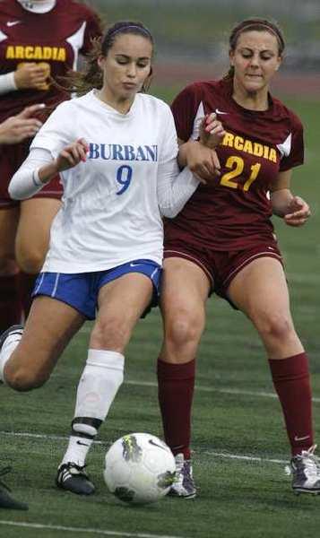 Burbank's Dakota Briseno battles for the ball against Arcadia's Mickey Cappello.