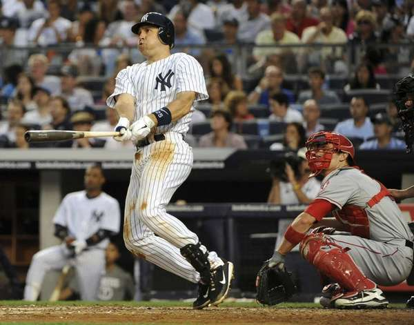Mark Teixeira of the New York Yankees watches his home run in the bottom of the third inning against the Los Angeles Angels of Anaheim at Yankee Stadium on July 13, 2012.