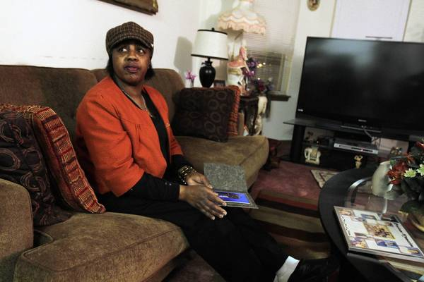Shirley Chambers sits in her Near North Side home Monday after buying a burial suit for her son Ronnie Chambers, who was killed early Saturday. All four of Shirley Chambers' children have lost their lives to gun violence.