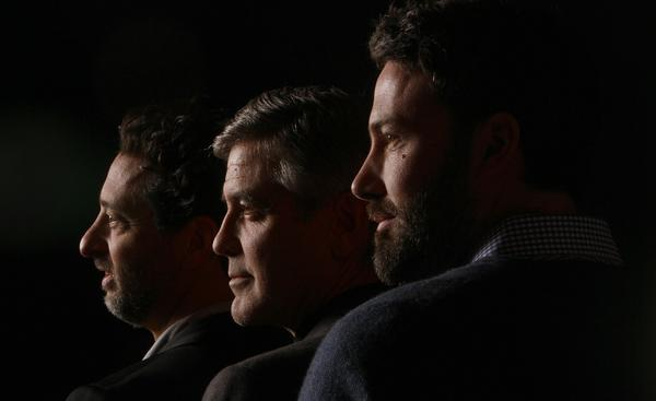 """Argo"" producers Grant Heslov, left, and George Clooney with producer-director-star Ben Affleck. It took Clooney and Heslov a while to decide on a director. They say Affleck was worth the wait."