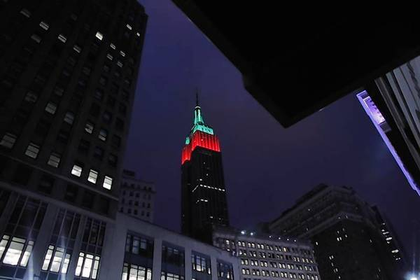 The Empire State Building is lit up in red and green on Christmas day in New York.