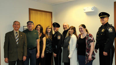 Officer Justin Evans, Scullton, was sworn in as a part-time officer Monday. From left: Mayor William Meyer, father-in-law Ed Baer, mother-in-law Jane Baer, fiancee Erin Baer, Officer Justin Evans, father Joe Evans, step-mother Gwynne Evans and her granddaughter Shantel Younkin.