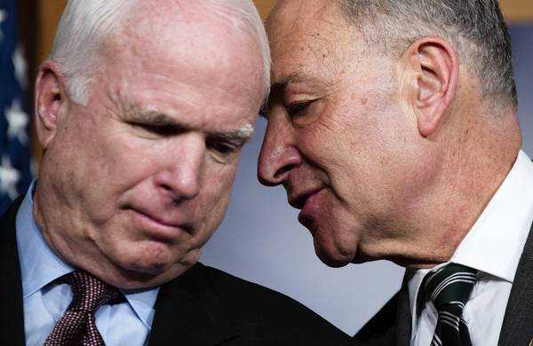Sens. John McCain (R-Ariz.), left, and Charles E. Schumer (D-N.Y.) confer at a news conference in which they expressed optimism about an immigration overhaul proposal.