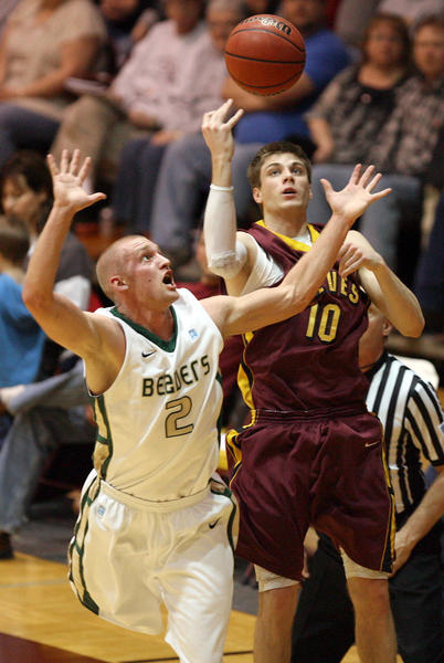 Lance Rongstad (2) of Bemidji State and Michael Emge of Northern State reach for a loose ball last season.