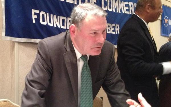 Big East Commissioner Mike Aresco chats with guests following his appearance at the Middlesex Chamber of Commerce breakfast on Monday.
