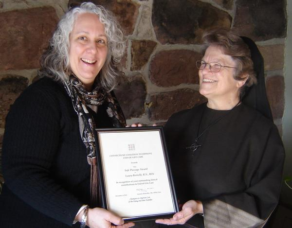 Laura Borrelli, RN, BSN, Hospice Director, Franciscan Home Care and Hospice Care, Meriden, is shown with Sister Suzanne Gross, FSE, Administrator, receiving the Connecticut Coalition to Improve End-of-Life Care Safe Passage Award For Outstanding Clinical Care at the recently held 14th Annual Meeting of the Connecticut Coalition.