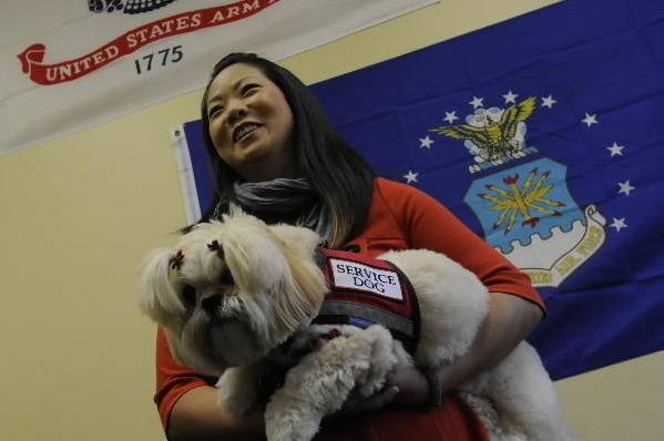 Sandra Lee, with her dog, Emma, at the veterans lounge at Manchester Community College, where she takes classes.