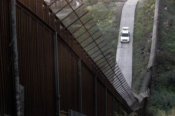 A Border Patrol vehicle near the fence separating Arizona and Mexico.
