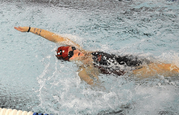 Above: George Rogers Clark High¿School swimmer Drew Coleman swims in the back leg of the girls 200 medley relay Monday afternoon.