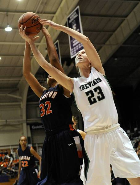 Evanston's Alecia Cooley and NewTrier's Jeannie Boehm go for a loose ball during a basketball game in Evanston at Welsh-Ryan Arena.