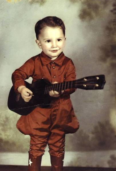 Charlie Haden at age 3 playing a ukulele