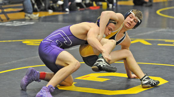 Gaylord's Matt Kempfer tries to get out of trouble in a match against Gladstone's Jared Syverson during the Northern Michigan Wrestling Championships Saturday at Gaylord High School. Kempfer lost the match 11-4 but the Blue Devils took first overall in the tournament.