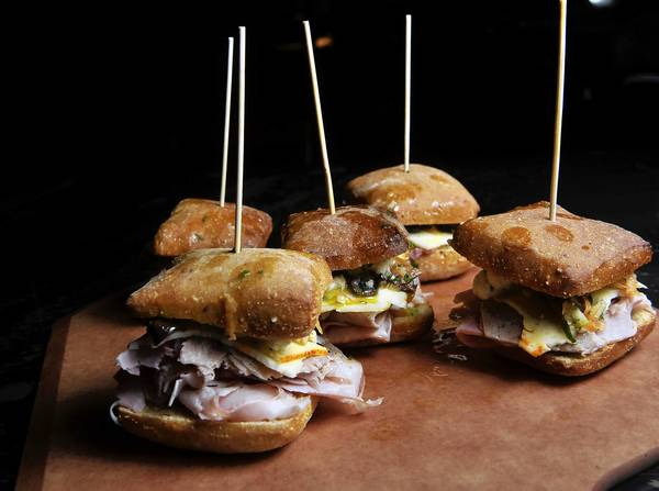 Mini-muffaletta sandwiches, one of the suggestions for Super Bowl party food from Thomas Dunklin, Executive Chef of B&O American Brasserie.
