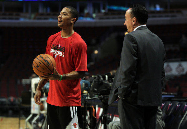 The Bulls' Derrick Rose and general manager Gar Forman before Monday's game against Charlotte at the United Center.