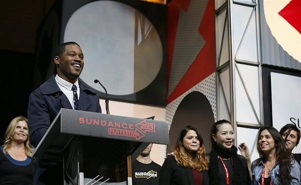 Ryan Coogler accepts a prize for his 'Fruitvale' at the Sundance Film Festival