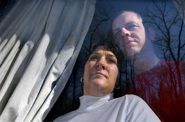 Glenn and Lisa Johnson of Gales Ferry were two of the Connecticut survivors of the Rhode Island nightclub fire at The Station in February 2003.  A year later Glenn and Lisa still had the scars of that tragic night. Glenn is still healing from burns to his back and Lisa deals with the mental scars of that evening.