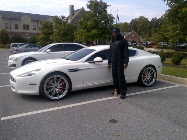 Ravens defenseman Lardarius Webb at the Ravens' castle with an Aston Martin Rapide.