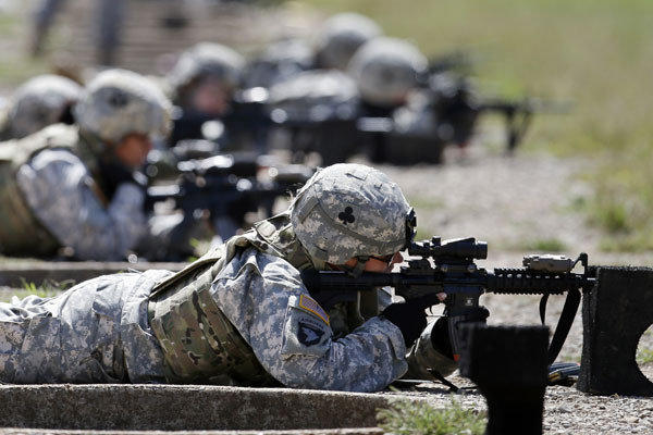 Female soldiers from the 1st Brigade Combat Team, 101st Airborne Division, train on a firing range at Fort Campbell, Ky.