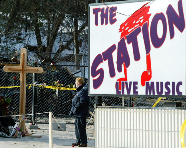 A man who declined to give his name visits the site of the deadly fire at The Station nightclub.  A cross placed at the scene remembers the 100 deaths from the fire.