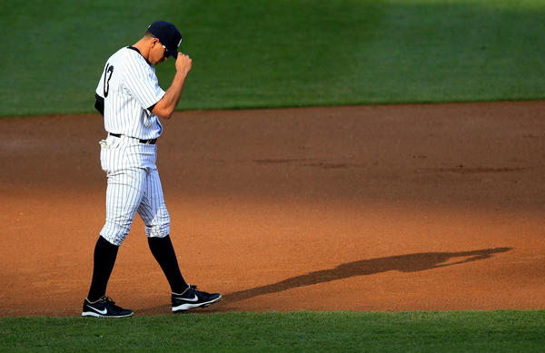 ankees third baseman Alex Rodriguez paces on the field during game two of the 2012 ALCS against the Detroit Tigers.