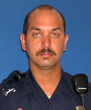 "New Haven Officer Juan Monzon, a 14-year veteran, turned himself in at New Haven police headquarters in connection with a domestic assault.  <a href=""/news/connecticut/hc-new-haven-officer-arrested-0130-20130129-001,0,7364901.photo"">Read more</a>"