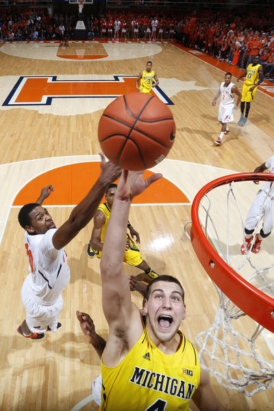Mitch McGary #4 of the Michigan Wolverines rebounds against Myke Henry #20 of the Illinois Fighting Illini during the game at Assembly Hall on January 27, 2013 in Champaign, Illinois. Michigan defeated Illinois 74-60.