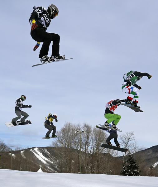 Sweden's Folger Forsen (black), Slovenia's Rok Rogelj (white), France's Tony Ramoin (yellow), Italty's Luca Matteotti (green), Canada's Kevin Hill (red) and France's Pierre Vaultier (blue) compete during the men's Snowboard-Cross eighth-finals at the FIS Snowboard World Championships in Stoneham, Quebec, January 26, 2013.