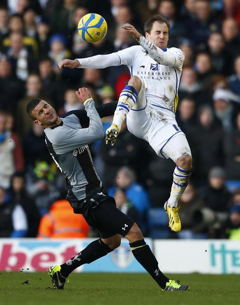 Leeds United's Luke Varney challenges Tottenham Hotspur's Kyle Walker (R) during their FA Cup fourth round soccer match at Elland Road in Leeds, northern England, January 27, 2013.