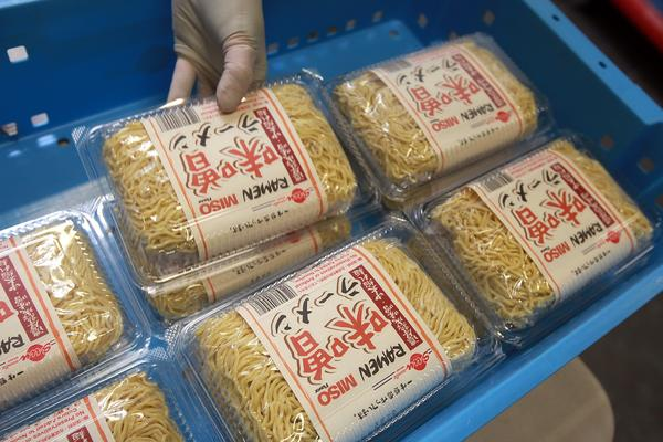 Freshly packaged ramen noodles are stacked for distribution at the Sun Noodle factory in Compton.
