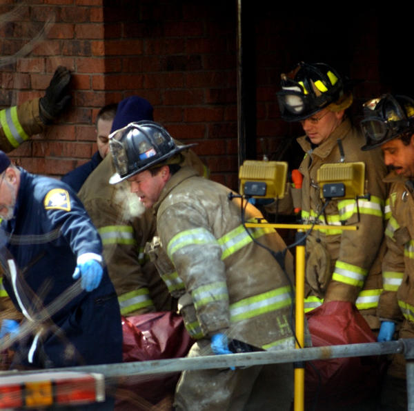 (GRAPHIC IMAGE) Hartford firefighters remove the body of one of the victims at the Greenwood Health Center fire.