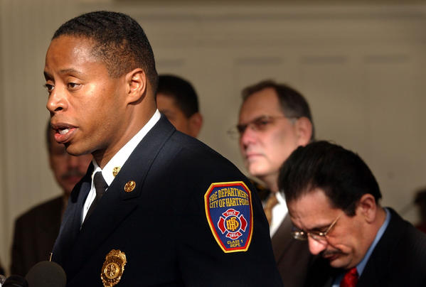 Hartford Fire Chief Charles Teale talks about the tragic deaths at the Greenwood Health Center where a fire claimed the lives of sixteen patients.  Behind Teale is Hartford Mayor Eddie Perez.