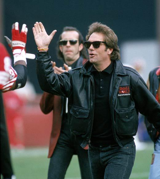 Super Bowl XLVII: Famous Baltimore Ravens and San Francisco 49ers fans: Check this news -- Huey Lewis pictured here at a 49ers game in 1991. Lewis was raised in the San Francisco Bay area.