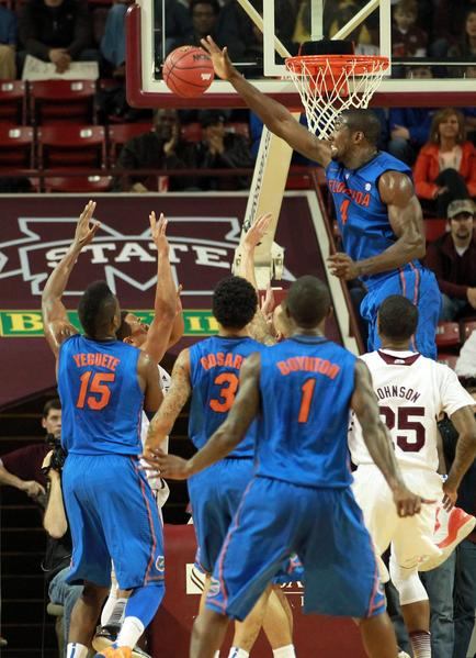 Florida Gators center Patric Young (4) knocks the ball away from the basket during the game against the Mississippi State Bulldogs at Humphrey Coliseum.