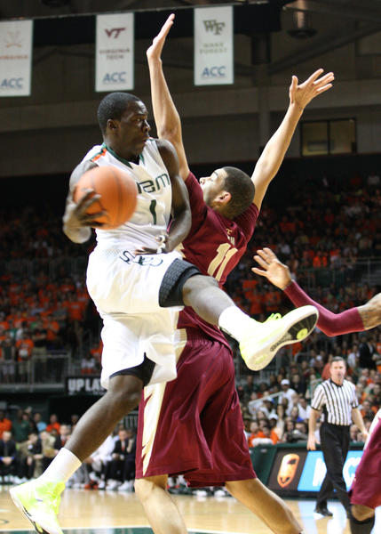 Miami guard Durand Scott tries to pass off the ball during the first half against Florida State at the BankUnited Center in Coral Gables, Florida, Sunday, January 27, 2013.