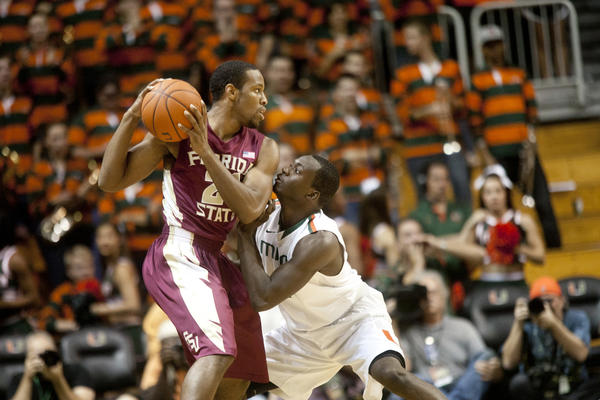 Michael Snaer of Florida State is guarded by Durand Scott of Miami during a men's college basketball game at the BankUnited Center in Coral Gables, Florida, Sunday, January 27, 2013.