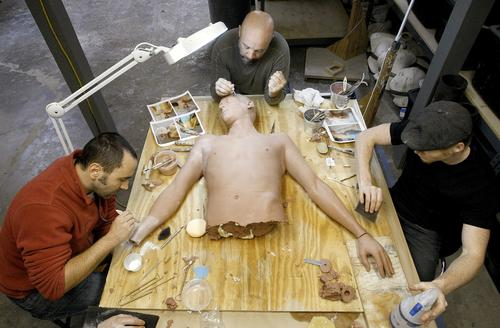 "Daniel Tirinnanzi, left, Barney Burman and Ian Von Cromer work on a clay sculpture at B2FX in North Hollywood. The sculpture is for a character on the NBC television series ""Grimm"" who will get cut at the waist."